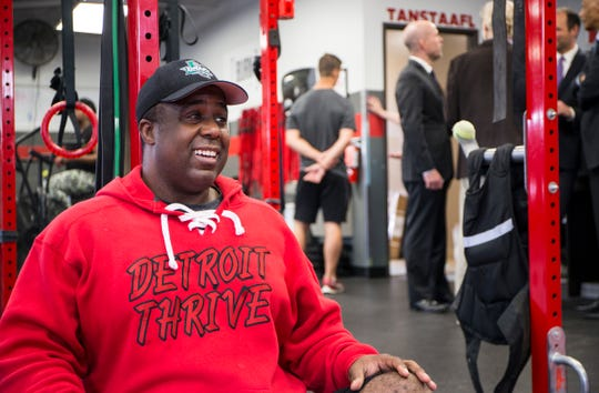 Mike Fox, owner of Detroit Thrive fitness, coaches clients at his gym in Detroit on June 6, 2019.