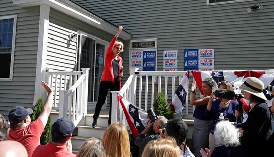Democratic presidential candidate Sen. Elizabeth Warren, D-Mass., talks with supporters at a campaign house party, Friday, June 14, 2019, in Windham, N.H.