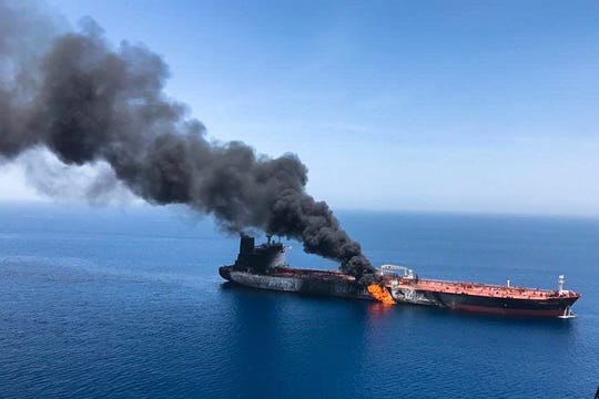 An oil tanker is on fire in the sea of Oman, on Thursday.