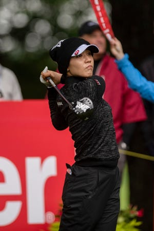Lydia Ko, of New Zealand, watches her tee shot on the first hole during the first round of the Meijer LPGA Classic golf tournament on Thursday.