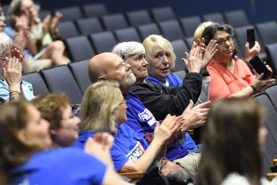 Attendees cheer as U.S. Rep. Andy Levin speaks of the start of impeachment proceedings on President Trump at Berkley High School.