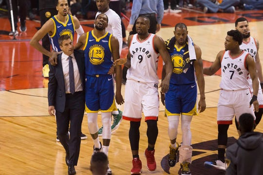 In this Monday, June 10, 2019 file photo, Golden State Warriors forward Kevin Durant walks off the court after sustaining an injury.