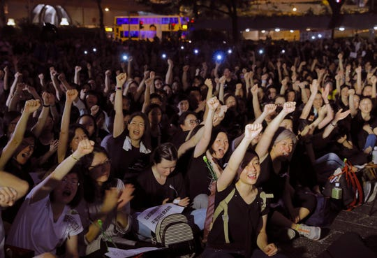 Hundreds of mothers protest against the amendments to the extradition law in Hong Kong on Friday.