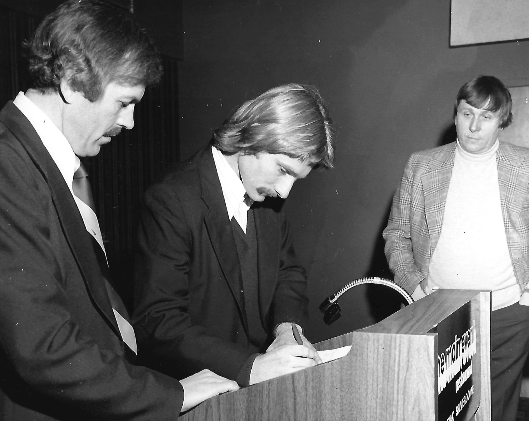 Detroit Express co-owner Roger Faulkner, right, and public relations director Gordon Preston attend the news conference announcing the signing of defender Paul Hunter from the New York Cosmos in 1978.