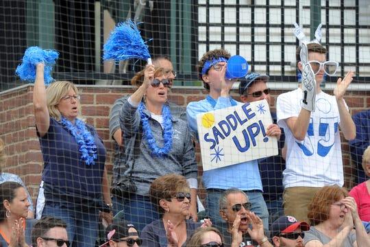 Warren Regina softball fans cheer on their team.