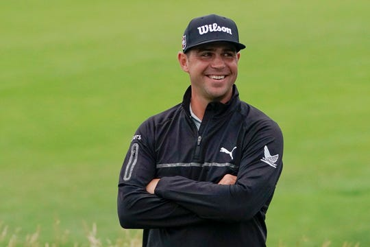 Gary Woodland smiles after finishing the second round in the U.S. Open golf tournament Friday.