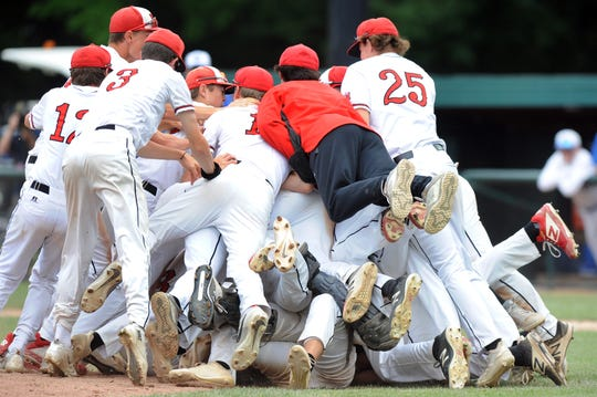 The Orchard Lake St. Mary's baseball team celebrates its state championship.