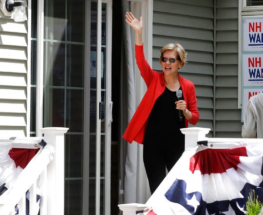 Democratic presidential candidate Sen. Elizabeth Warren, D-Mass., waves as she arrives at a campaign house party, Friday, June 14, 2019, in Windham, N.H.