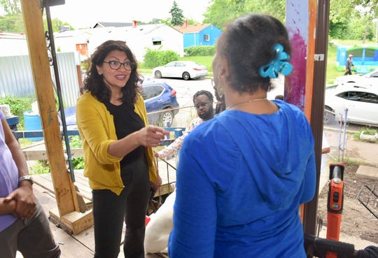 Congresswoman Rashid Tlaib, left, thanks Sonia Brown, for her efforts with Auntie Na's Village.