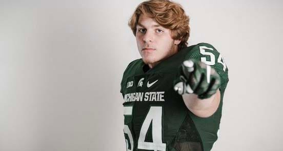 Michigan State received a commitment Friday night from New Palestine (Indiana) defensive end Kyle King.