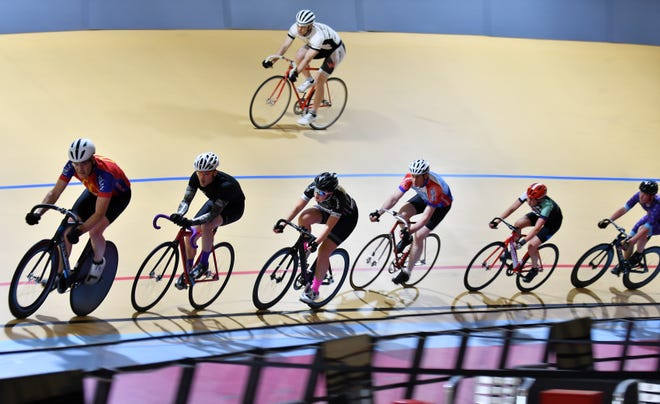 Charles Moore, 45, of Plymouth, top, rides warm up laps at Detoit's Lexus Velodrome with, bottom from left, Mark Atkinson, 51, of Northville, Craig Batory, 29, of Detroit, Autumn Caya, 15, of Shelby Township, Kurt Westphal, 56, of Northville, Rebecca Hartrick, 16, of Auburn Hills and Jackson Robar, 27, of Detroit.