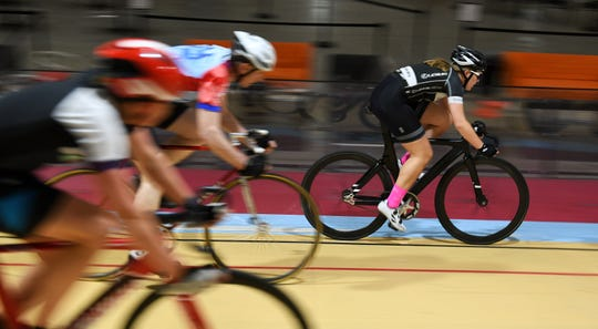 Autumn Caya, 15, of Shelby Township, right, rides warm up laps at the Thursday night structured training.