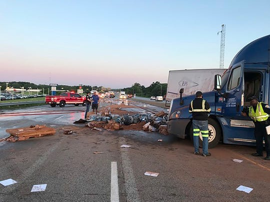 This Friday, June 14, 2019 photo released by Indiana State Police shows a scene of a crash involving two semi-trucks closed a stretch of freeway in northwestern Indiana and scattered cargo including cocoa powder and batteries in eastbound Interstate 94 in Burns Harbor, Ind.