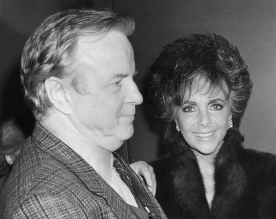 "In this April 10, 1987 file photo,Franco Zefferelli, producer and set designer of the Puccini opera ""Turandot,"", escorts Liz Taylor to her limousine after the performance."