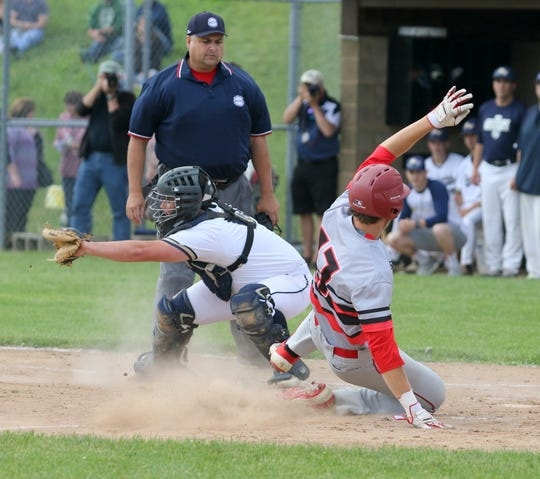 Robert Copozzi of Center Moriches slides safely home in front of Susquehanna Valley catcher Dan Matthews during a Class B baseball state semifinal June 14, 2019 at SUNY Broome Community College in Binghamton.