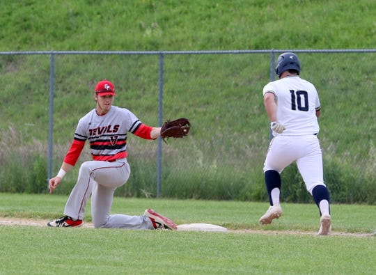 Center Moriches first baseman Robert Copozzi scoops a low throw at first base to retire Susquehanna Valley's Dan Matthews during a Class B baseball state semifinal June 14, 2019 at SUNY Broome Community College in Binghamton.