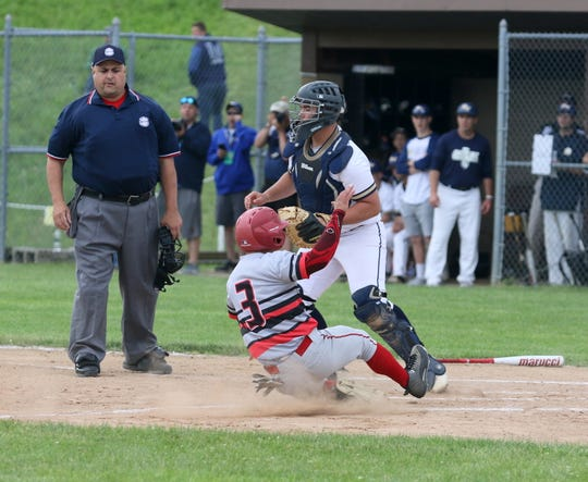 Corey Stengel of Center Moriches slides home safely in front of Susquehanna Valley catcher Dan Matthews in a Class B baseball state semifinal June 14, 2019 at SUNY Broome Community College in Binghamton.