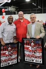 "Jon ""The Big Nut"" Peters, of Fremont,  center, presents Archie Griffin, left, and Jim Tressel with posters featuring him in full Big Nut gear. The ""Journey for All Kids"" charity benefit with the OSU legends was held at Journey's Family Amusement Center in Fremont on Friday."