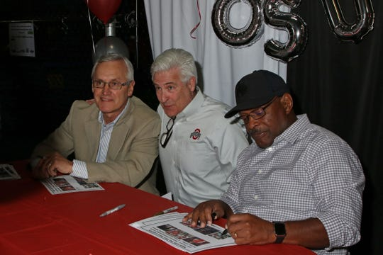 "Former OSU coach Jim Tressel and two time Heisman Trophy winner Archie Griffin posed for photos with fans and signed autographs at the ""Journey for All Kids"" charity benefit in Fremont on Friday."