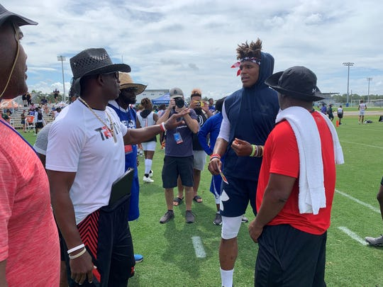 Deion Sanders and Cam Newton have a brief conversation prior to squaring off in the NFA 7v7 National Championships Saturday afternoon, held at IMG Academy.