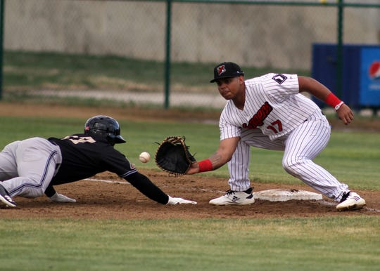 Great Falls first baseman Harvin Mendoza looks to apply the tag on a pick-off attempt during the Voyagers' home opener at Centene Stadium Friday night.