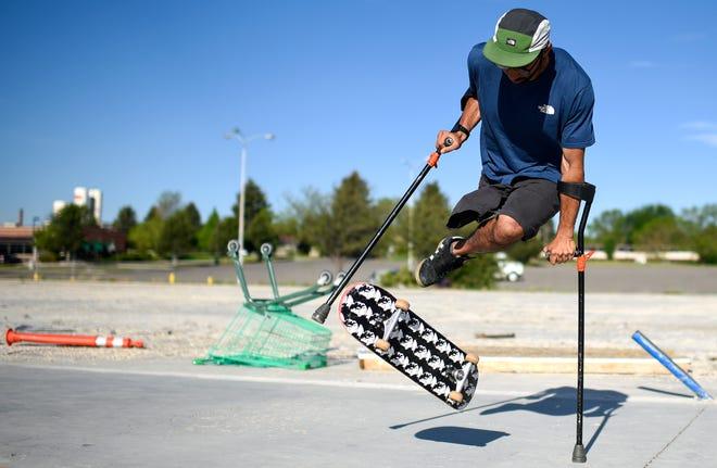 Vasu Sojitra, the first sponsored North Face adaptive athlete and adaptive sports program director at Eagle Mount Bozeman, practices skateboarding tricks during a photo shoot on Thursday, June 6, 2019. (Rachel Leathe/Bozeman Daily Chronicle via AP)