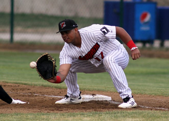 Great Falls Voyagers' first baseman Harvin Mendoza, pictured on Opening Day Friday, got the Voyagers' first round-tripper of the season and helped the defending Pioneer League champs get their first win of the year, a 5-3 victory over Missoula Saturday.