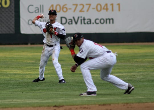 Great Falls Voyagers outfielder Kelvin Maldonado makes a throw to home plate in the team's home opener at Centene Stadium Friday night.
