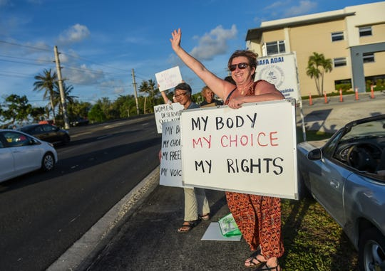 A group of Pro-Choice supporters protest directly across a Pro-Life rally in Adelup on June 14, 2019.