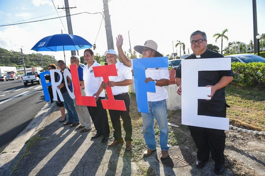 Dozens of Pro-Life supporters hold a rally at a Route 1 intersection in Adelup on June 14, 2019.
