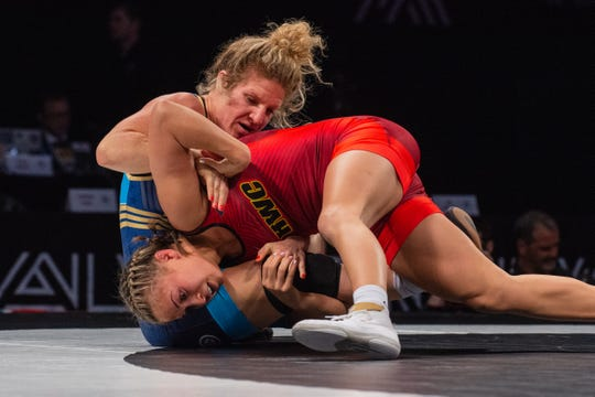 Hawkeye Wrestling Club's Alli Ragan, in red, wrestles against Lauren Louive at Final X at the Bob Devaney Sports Center in Lincoln, Neb. Ragan won the series, two matches to none, to make the 2019 women's freestyle world team.