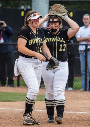 Howell's Maddie Gillett and Avrey Wolverton (13) react following a 3-2 eight-inning loss to Warren Regina in the state Division 1 championship softball game on Saturday, June 15, 2019.