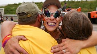Patti Stephens and Bob Wolz offered up free hugs at Kentuckiana Pride Parade.