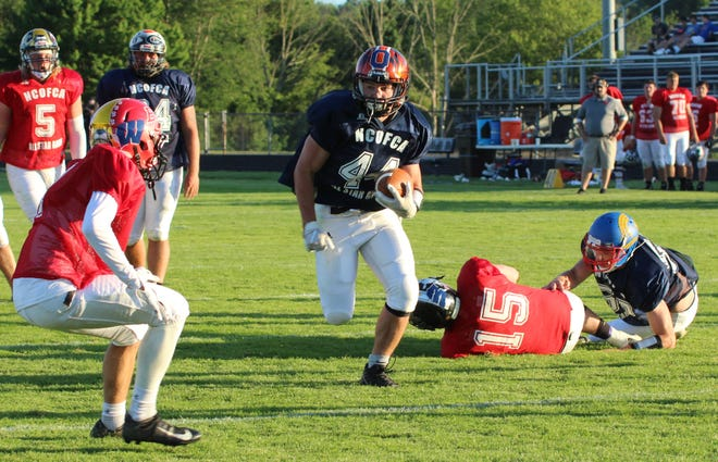 Lucas running back Jeb Grover scores on a 7-yard touchdown run to go with his 46-yard scoring catch for the South in its 46-32 win over the North in Friday's 34th NCOFCA All-Star Football Classic at Lexington High School.