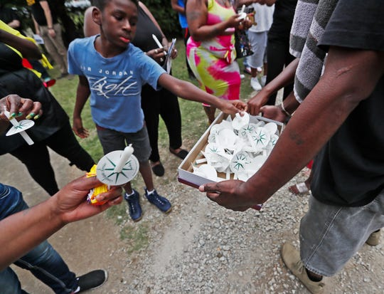 Candles are passed out as community members gather near the Frayser home of Brandon Webber on Friday, June 14, 2019.  While attempting to serve a warrant, U.S. Marshals Service task force shot and killed Webber on Wednesday, June 12, 2019, sparking a riot that injured members of the Memphis Police Department and Shelby County Sheriff's Office.
