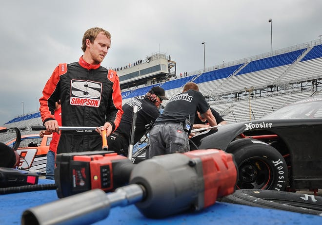 Driver Travis Braden works on his car during practice for the 2019 ARCA Midwest Tour Father's Day 100 at the Milwaukee Mile.