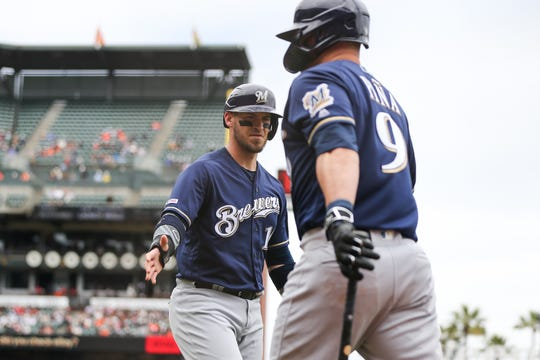Yasmani Grandal (left) launched from fifth place to third in the latest round of all-star voting, putting him in position to earn a spot in 'The Starters Election.'