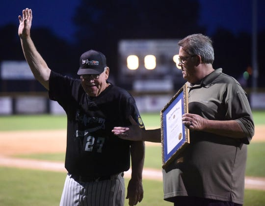 Lockeroom head coach Lester White is congratulated Friday night by the home fans after recently being inducted into the Arkansas American Legion Hall of Fame. Chris Robinson is pictured holding White's Hall of Fame plaque. White earned his 980th career victory as coach of the team on Friday night.