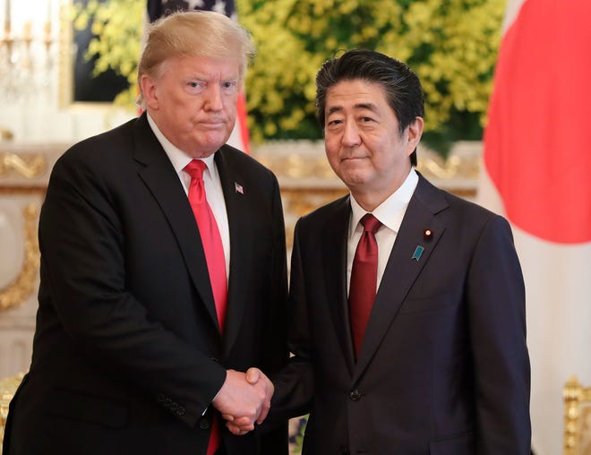 U.S. President Donald Trump, left, and Japanese Prime Minister Shinzo Abe shake hands prior to their meeting at Akasaka Palace, Japanese state guest house in Tokyo, Monday, May 27, 2019.(AP Photo/Eugene Hoshiko, Pool)