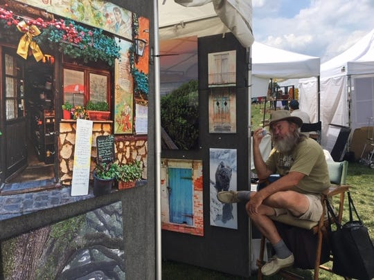 Photographer Brian Miller sells  photographs at the American Artisan Festival in Centennial Park on Saturday, June 15, 2019.
