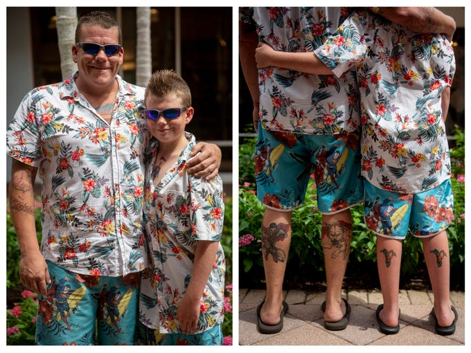 Chris Urbanski, left, and Christopher Urbanski, 10, right, pose for a portrait after winning a father and son lookalike contest at Miromar Outlets in Estero on Saturday, June 15, 2019. Christopher wore temporary tattoos to mimic his dad's real ones, but the father and son pair said they already owned their matching outfits.