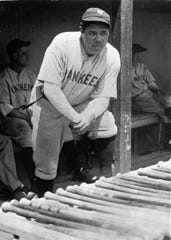 Babe Ruth, the Yankees' big bludgeon man, stands in the dugout during a game at Cleveland July 19, 1929.