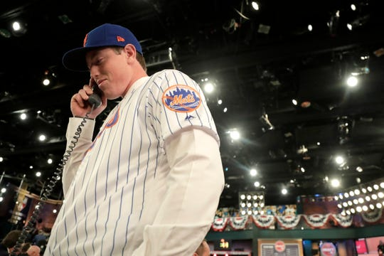 Brett Baty, a third baseman from Lake Travis High School in Austin, Texas, talks on the phone with New York Mets personnel after being selected No. 12 by the Mets in the first round of the Major League Baseball draft, Monday, June 3, 2019, in Secaucus.