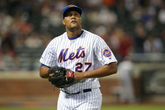 Jun 14, 2019; New York City, NY, USA; New York Mets relief pitcher Jeurys Familia (27) reacts after allowing the St. Louis Cardinals to score four runs during the eighth inning at Citi Field.