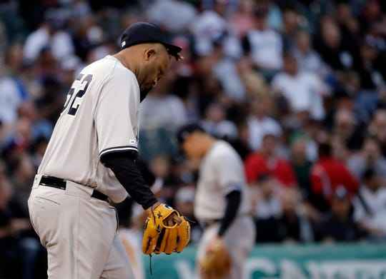 New York Yankees starting pitcher CC Sabathia reacts as he looks down during the first inning of a game against the Chicago White Sox in Chicago, Friday, June 14, 2019.