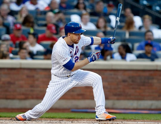 New York Mets' Todd Frazier hits an RBI single during the first inning of the team's game against the St. Louis Cardinals, Friday, June 14, 2019, in New York.