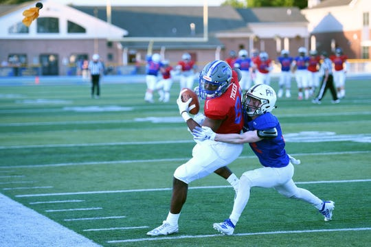 Bergen County Football All-Star Game at Lyndhurst High School on Friday, June 14, 2019. South #81 Nadame Tucker, of Teaneck, makes a catch as North #12 Tyler Deppert, of Pascack Hills, defends. There was a flag on the play against the South.