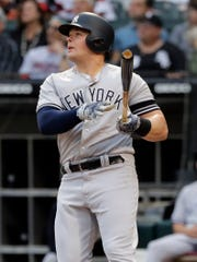 New York Yankees' Luke Voit watches his solo home run against the Chicago White Sox during the first inning of a game in Chicago, Friday, June 14, 2019.