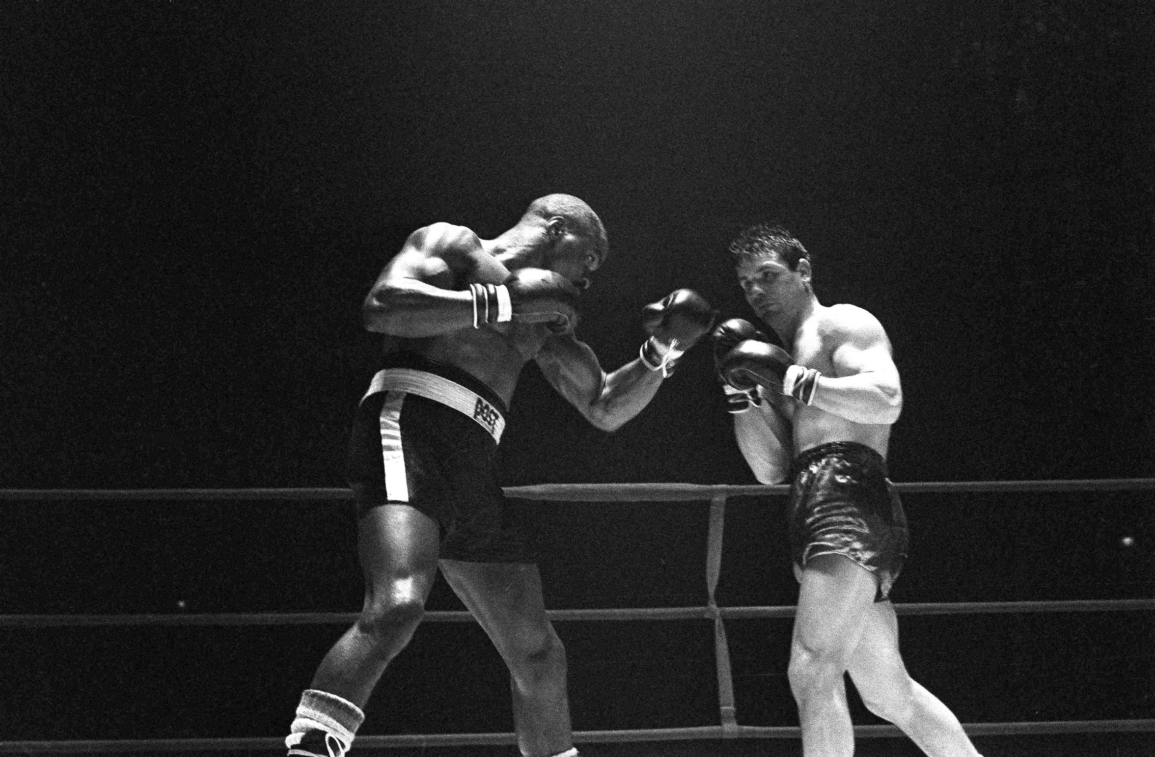 In this Feb. 23, 1965 file photo, Rubin Hurricane Carter, left, knocks out Italian boxer Fabio Bettini in the 10th and last round of their fight at the Falais Des Sports in Paris.