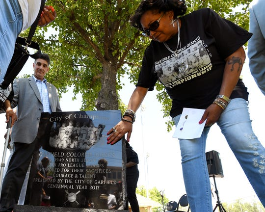 The Garfield Black History Committee celebrates the Garfield Colored Giants who won the North Jersey National League semi-pro baseball championships in 1949. Denise Maria Buggs Williams touches a memorial to the Garfield Colored Giants during an unveiling ceremony on Saturday, June, 15, 2019. Her father, Purvis Buggs, played on the team.